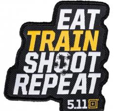 5.11 ''EAT, TRAIN, SHOOT, REPEAT'' -kangasmerkki, velkrolla